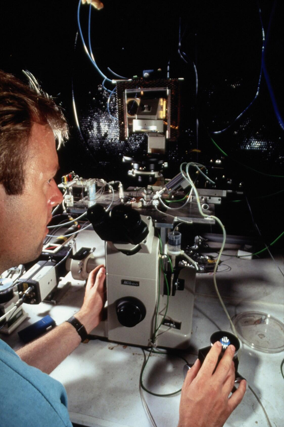 Researcher using patch clamping apparatus for ion | Wellcome Collection