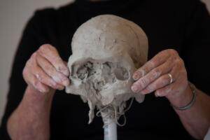 view Human head sculpted in clay, forming the cheekbones