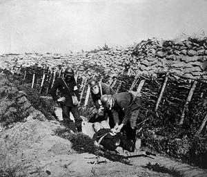 view World War One: stretcher bearers wearing gas masks