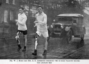 view Two athletes with artificial right legs walking. 1925