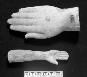 view Votive offerings in the form of the hand and forearm. Apparently terracotta.