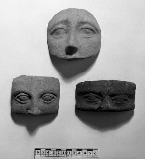view Votive offerings in the form of the eyes. Apparently made of terracotta.