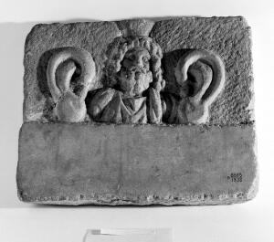 view Marble votive plaque with relief bust, possibly Serapis.