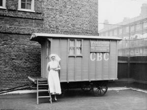 view Birth control clinic in caravan, with nurse.