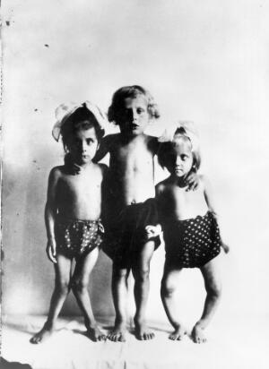 view Photograph: three children with rickets