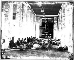 view Buddhist priests eating, Bangkok, Siam