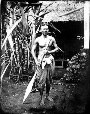 view Siamese boatman, holding an oar. Siam