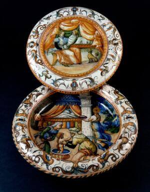view Two ceramic plates with childbirth scenes