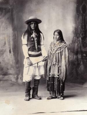 view A native American man and woman. Platinum print by F.A. Rinehart, 1898.