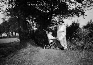 view A physically handicapped boy sitting in a wheelchair. Photograph, ca. 1910/1925.