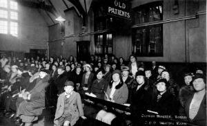 view The German Hospital, Dalston: patients waiting in the waiting room. Photograph by Marshall, Keene & Co.