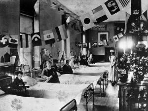 view Hahnemann Hospital and Homœopathic Dispensaries, Liverpool: a ward, decorated with flags possibly for the coronation of King George V. Photograph.