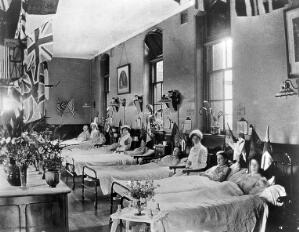view Hahnemann Hospital and Homœopathic Dispensaries, Liverpool: a women's ward, decorated with flags possibly for the coronation of King George V. Photograph.