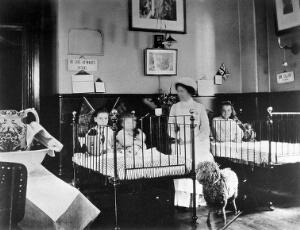 view Hahnemann Hospital and Homœopathic Dispensaries, Liverpool: a children's ward, decorated with flags possibly for the coronation of King George V. Photograph.