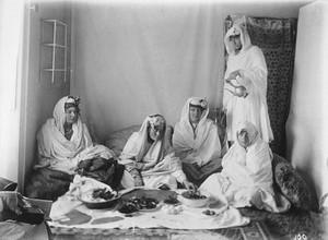 view Ladies of the royal harem enjoying an Afghan meal. Kabul