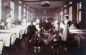 view A hospital ward with Christmas decorations. Photographic postcard.