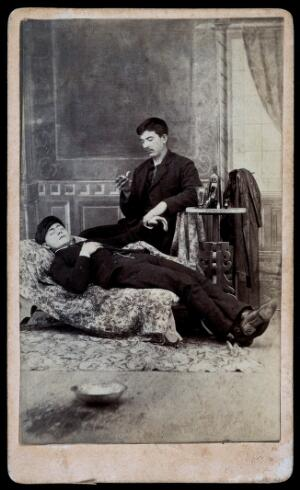 view A man taking the pulse of another man. Albumen print.