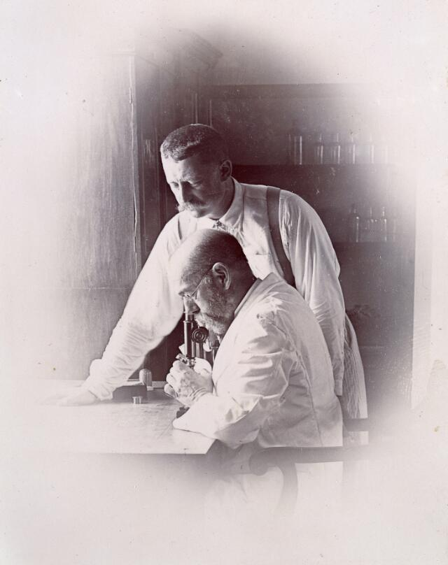 Robert Koch and Richard Pfeiffer working in a laboratory, investigating the plague in Bombay. Photograph attributed to Captain C. Moss, 1897.