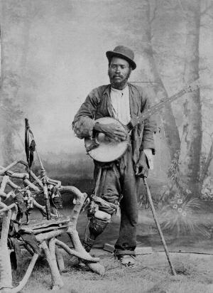 view A black banjo player with a wooden leg. Photograph, ca. 1865 (?).