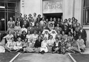 view Birmingham Hospital Saturday Fund Convalescent Home, Kewstoke, Weston-super-Mare: nurses (?) outside the patients' entrance. Photograph by R.W. Brown & Son, 1936.