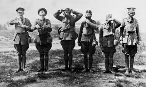 """view Six soldiers demonstrating putting a gas mask on over the face. """"To show stages in adjustment of a SBR""""."""