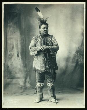 view Yellow Smoke, a member of the Omaha tribe. Platinum print by F.A. Rinehart, 1899.