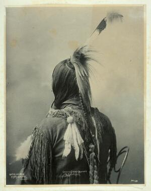 view The back of an Omaha Indian. Platinum print by F.A. Rinehart, 1899.