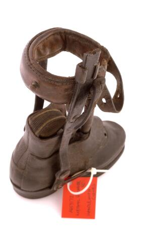 view A Victorian child's shoe and leg caliper in leather and steel