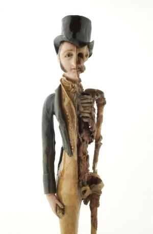 view A male memento mori figure used for spiritual contemplation