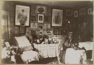 view Nurse Tremlow (name unconfirmed), a monthly nurse to gentry and royal households, in retirement, with photographs of her employers. Photograph, 19--.