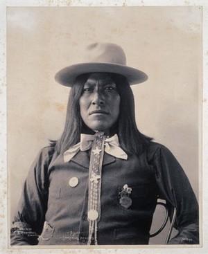 view Assuz, a member of the San Carlos Apache. Platinum print by F.A. Rinehart, 1898.