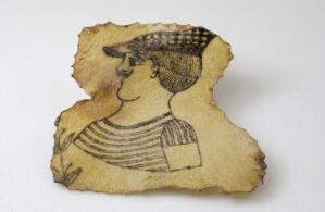 view A tattoos on a piece of human skin