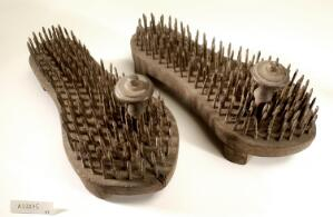 view A pair of fakir's sandals with iron spikes.