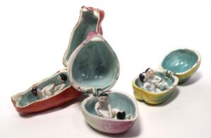 view Porcelain fruit containing couple engaged in sexual foreplay