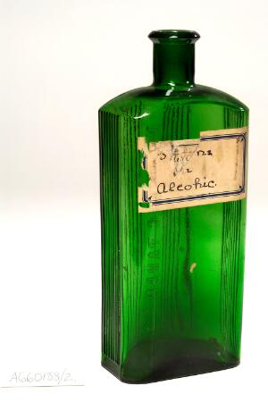 view Green glass poison bottle