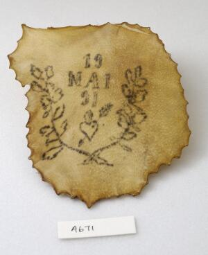 view A tattoo on a piece of human skin showing a heart with an arrow through it and the date of the 19th May 91