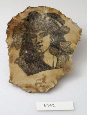 view A tattoo on a piece of human skin showing a female face