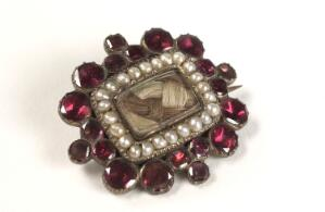 view Mourning brooch containing the hair of a deceased relative.