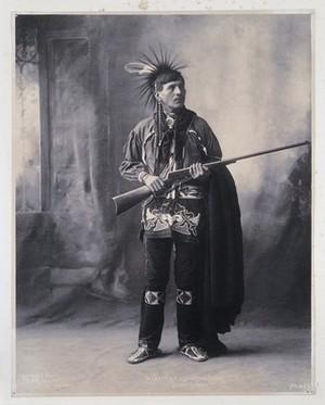view Moaz-Kida (Shooting Cedar), a member of the Winnebago tribe. Platinum print by F.A. Rinehart, 1899.