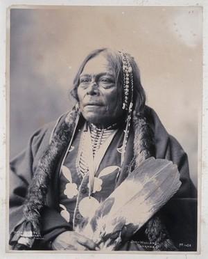 view John Williams, a member of the Tonkawa tribe. Platinum print by F.A. Rinehart, 1898.