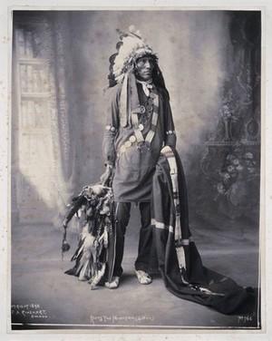 view Keeps the Mountain, a Sioux. Platinum print by F.A. Rinehart, 1898.