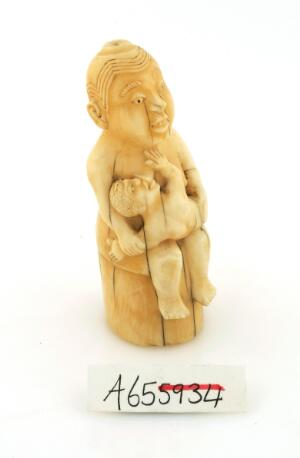 view Ivory effigy of mother and child