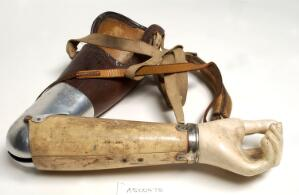 view Artificial left arm with shoulder straps. Made with leather and aluminium by W. R. Grossmith.