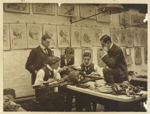 view The interior of a dissecting room: five students and/or teachers dissect a cadaver. Photograph, ca. 1900 (?).