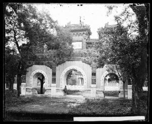 view Hall of Classics (Guozijian), Peking: a triple archway of sculpted marble leading to the hall. Photograph by John Thomson, 1871.