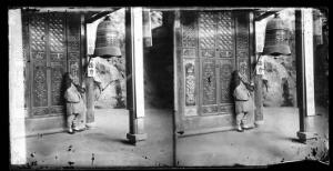 view Fangguangyan monastery, Fujian province, China: a monk ringing the bell. Photograph by John Thomson, 1870-1871.