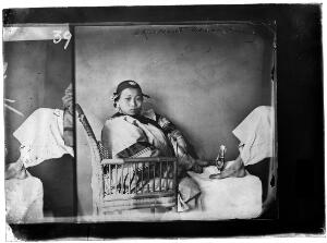 view Woman with bound feet, photograph by John Thomson