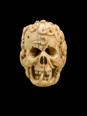 view Ivory model of half a human head, half a skull, Europe, undated