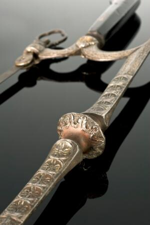 view Ornate bow-frame amputation saw, damascened in gold, ebony handle, c.1650, from the Hamonic collection. Detail view.