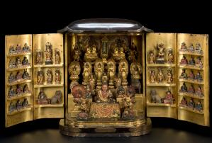 view Lacquered wooden domestic shrine with 66 figures of Shinto and Buddhist deities, Japanese, 19th century. Full view, doors open. Black background.